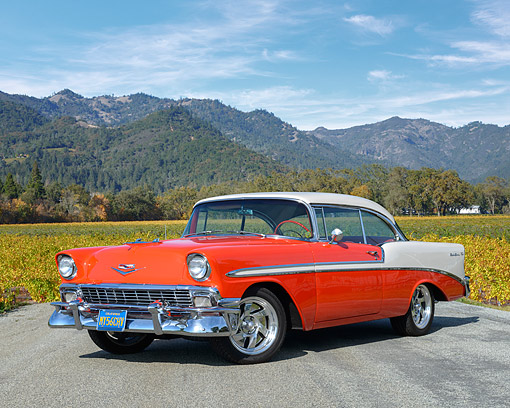 AUT 21 RK3437 01 © Kimball Stock 1956 Chevrolet Bel Air Red And White 3/4 Front View On Pavement By Hills