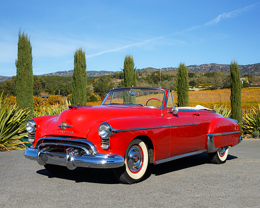 AUT 21 RK3573 01 © Kimball Stock 1950 Oldsmobile 88 Convertible Red 3/4 View On Pavement