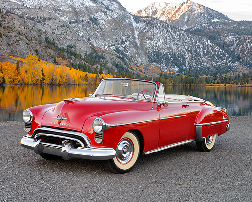 AUT 21 RK3574 01 © Kimball Stock 1950 Oldsmobile 88 Convertible Red 3/4 View On Pavement