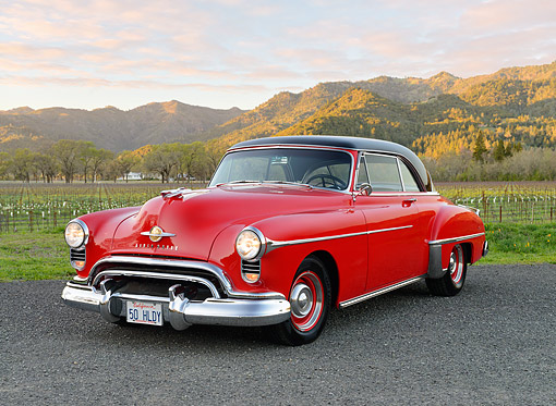 AUT 21 RK3579 01 © Kimball Stock 1950 Oldsmobile 88 Holiday Hardtop Red 3/4 Front View By Vineyard