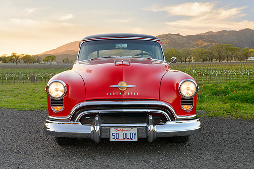 AUT 21 RK3580 01 © Kimball Stock 1950 Oldsmobile 88 Holiday Hardtop Red Front View By Vineyard