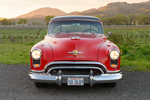 AUT 21 RK3581 01 © Kimball Stock 1950 Oldsmobile 88 Holiday Hardtop Red Front View By Vineyard