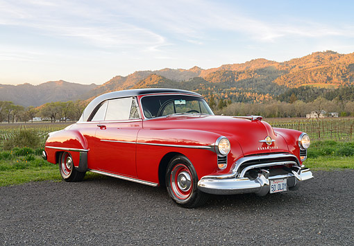 AUT 21 RK3582 01 © Kimball Stock 1950 Oldsmobile 88 Holiday Hardtop Red 3/4 Front View By Vineyard