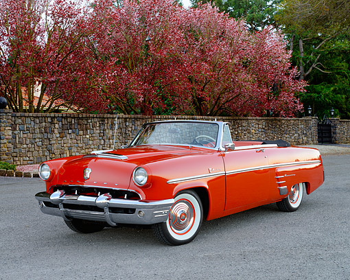 AUT 21 RK3588 01 © Kimball Stock 1953 Mercury Monterey Convertible Red 3/4 Front View On Pavement
