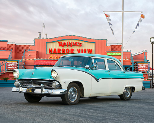 AUT 21 RK3593 01 © Kimball Stock 1953 Ford Fairlane Town And Country Sedan Blue And White 3/4 Front View At Stormy Harbor