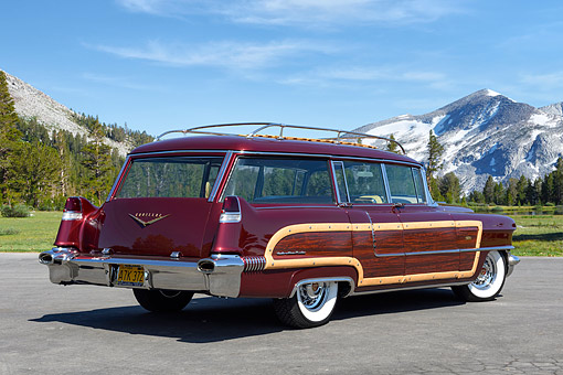 AUT 21 RK3596 01 © Kimball Stock 1956 Cadillac Viewmaster Wagon Chantilli Metallic 3/4 Rear View On Pavement By Forest Mountains