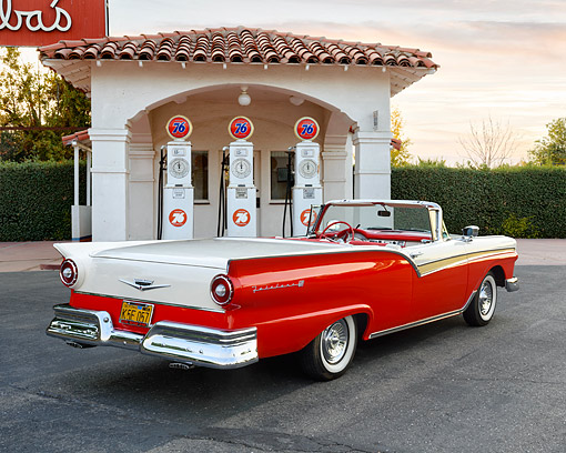 AUT 21 RK3601 01 © Kimball Stock 1957 Ford Fairlane 500 Skyliner Red And White 3/4 Rear View Pulling In To Gas Station