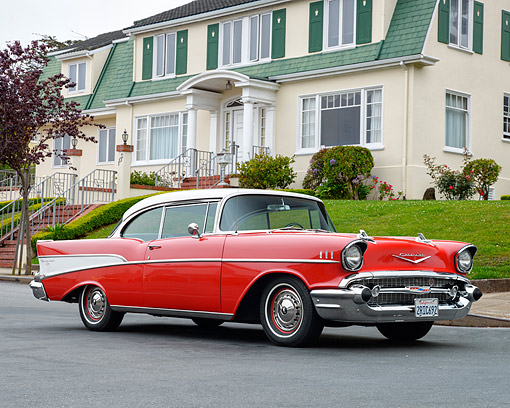 AUT 21 RK3604 01 © Kimball Stock 1957 Chevrolet Bel Air Red And White 3/4 Front View By House