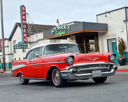 AUT 21 RK3605 01 © Kimball Stock 1957 Chevrolet Bel Air Red And White 3/4 Front View By House