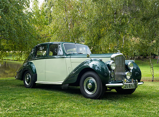 AUT 21 RK3613 01 © Kimball Stock 1953 Bentley R-Type Saloon Green And Yellow 3/4 Front View By Pond