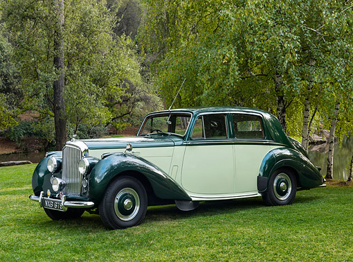 AUT 21 RK3614 01 © Kimball Stock 1953 Bentley R-Type Saloon Green And Yellow 3/4 Front View By Pond