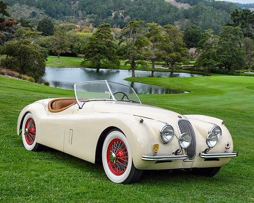 AUT 21 RK3618 01 © Kimball Stock 1954 Jaguar XK120 OTS White 3/4 Front View On Golf Course By Lake
