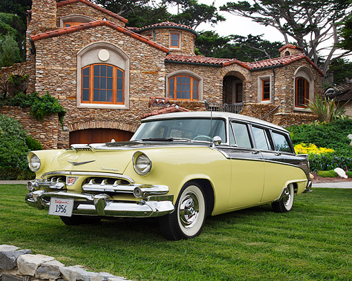 AUT 21 RK3622 01 © Kimball Stock 1956 Dodge Sierra Station Wagon Yellow 3/4 Front View On Grass By Mansion