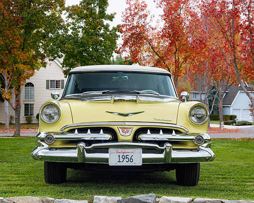 AUT 21 RK3623 01 © Kimball Stock 1956 Dodge Sierra Station Wagon Yellow Front View On Grass By Mansion