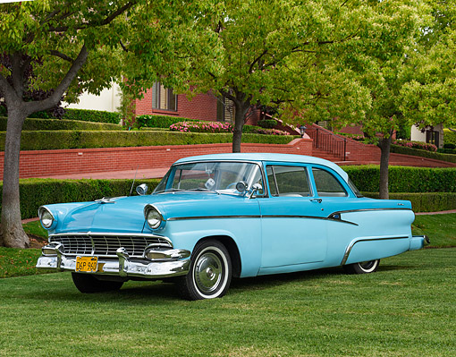 AUT 21 RK3624 01 © Kimball Stock 1956 Ford Customline Blue Sedan 3/4 Front View On Grass