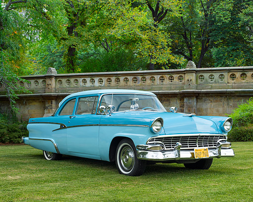 AUT 21 RK3625 01 © Kimball Stock 1956 Ford Customline Blue Sedan 3/4 Front View On Grass