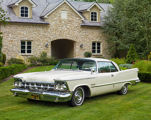 AUT 21 RK3631 01 © Kimball Stock 1959 Chrysler Imperial Crown White 3/4 Front View On Grass By House