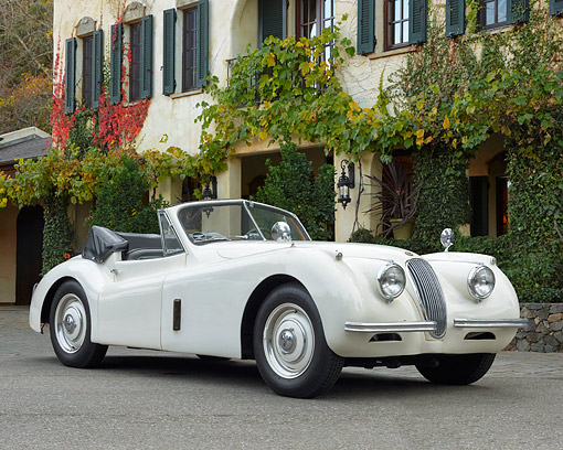 AUT 21 RK3633 01 © Kimball Stock 1953 Jaguar XK120 Drophead Coupe 3/4 Front View On Pavement