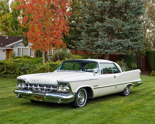 AUT 21 RK3641 01 © Kimball Stock 1959 Chrysler Imperial Crown Coupe White 3/4 Front View On Grass In Front Of House