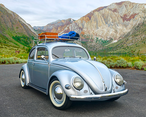 AUT 21 RK3643 01 © Kimball Stock 1956 Volkswagen Type 1 Silver 3/4 Front View By Mountainous Landscape