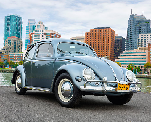 AUT 21 RK3644 01 © Kimball Stock 1957 Volkswagen Beetle Metallic Blue-Green 3/4 Front View By City