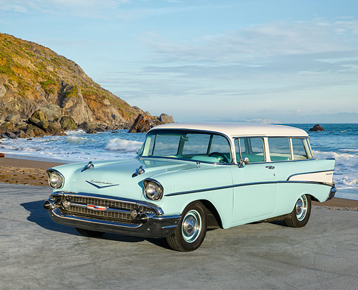 AUT 21 RK3652 01 © Kimball Stock 1957 Chevrolet 2-Door Station Wagon Turquoise 3/4 Front View By Ocean