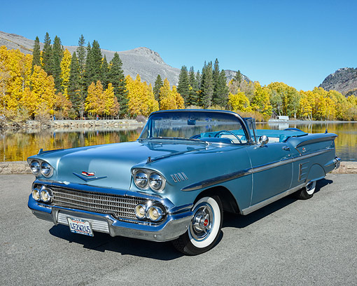 AUT 21 RK3659 01 © Kimball Stock 1958 Chevrolet Impala Convertible Blue 3/4 Front View By Lake And Trees