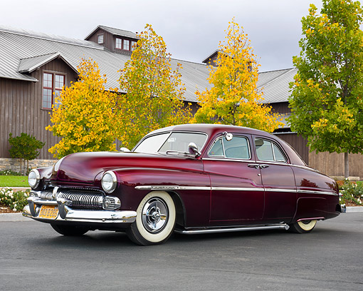 AUT 21 RK3663 01 © Kimball Stock 1950 Mercury Eight Custom Maroon 3/4 Front View On Pavement By Building