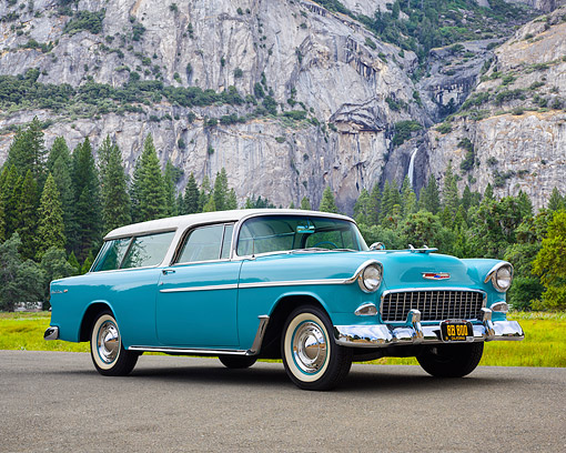 AUT 21 RK3669 01 © Kimball Stock 1955 Chevrolet Nomad Teal And White 3/4 Front View By Mountain And Trees