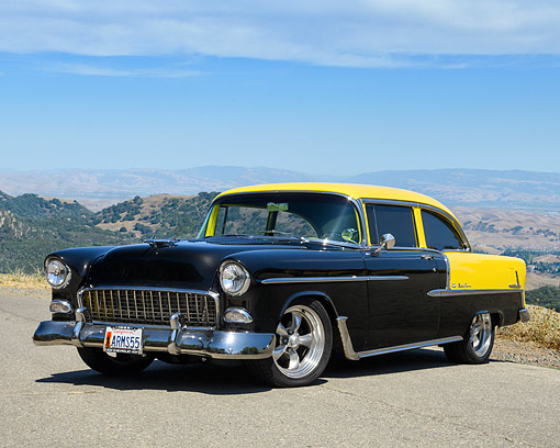 AUT 21 RK3674 01 © Kimball Stock 1955 Chevrolet Bel Air Black And Yellow 3/4 Front View By Hills