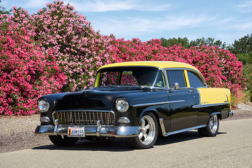 AUT 21 RK3675 01 © Kimball Stock 1955 Chevrolet Bel Air Black And Yellow 3/4 Front View By Flowers