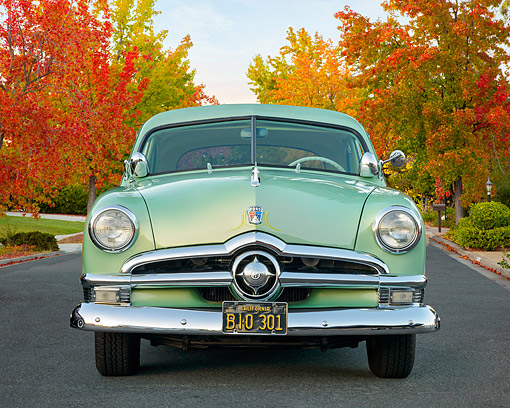 AUT 21 RK3697 01 © Kimball Stock 1950 Ford Custom Deluxe Club Coupe Type 72B Green Front View By Autumn Trees