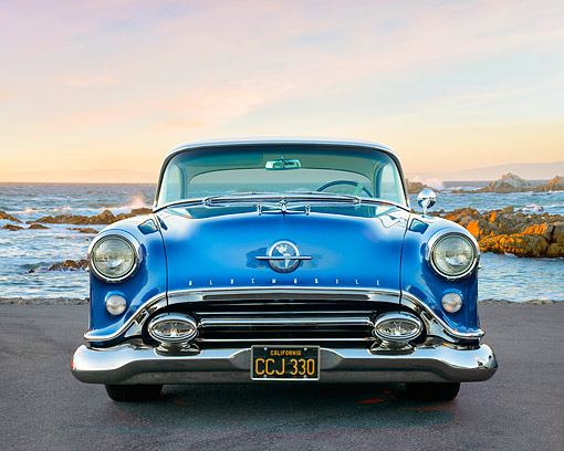 AUT 21 RK3698 01 © Kimball Stock 1954 Oldsmobile 88 Blue Front View By Ocean