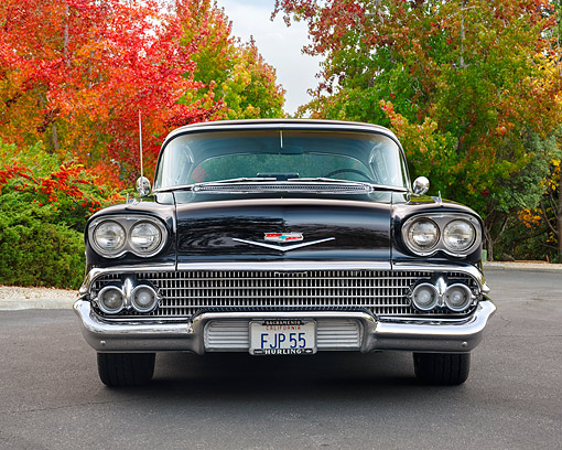 AUT 21 RK3703 01 © Kimball Stock 1958 Chevrolet Bel Air Impala Black Front View By Autumn Trees