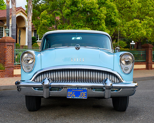 AUT 21 RK3705 01 © Kimball Stock 1954 Buick Special 4-Door Sedan Blue Front View By House And Trees