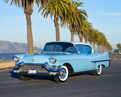 AUT 21 RK3710 01 © Kimball Stock 1957 Cadillac Series 62 4-Door Hardtop Blue 3/4 Front View By Beach