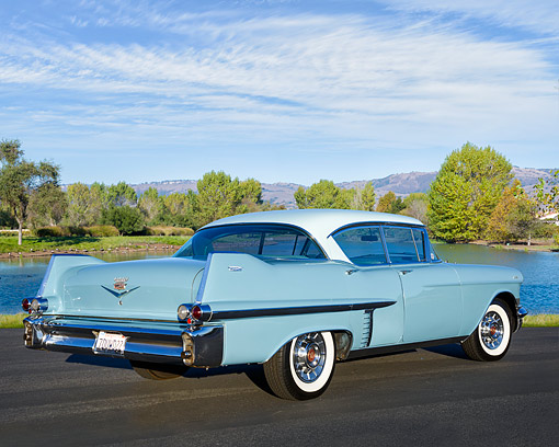 AUT 21 RK3711 01 © Kimball Stock 1957 Cadillac Series 62 4-Door Hardtop Blue 3/4 Rear View By Lake