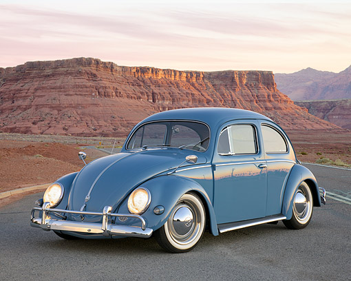 AUT 21 RK3715 01 © Kimball Stock 1957 Volkswagen Beetle Blue 3/4 Front View On Road In Desert