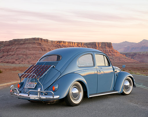 AUT 21 RK3716 01 © Kimball Stock 1957 Volkswagen Beetle Blue 3/4 Rear View On Road In Desert