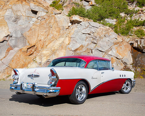 AUT 21 RK3718 01 © Kimball Stock 1955 Buick Special Riviera Coupe Red And White 3/4 Rear View By Granite