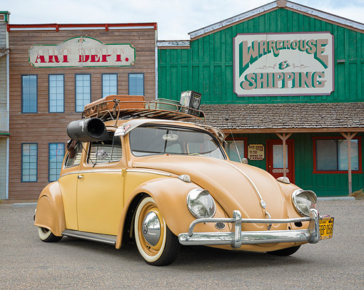 AUT 21 RK3730 01 © Kimball Stock 1958 Volkswagen Beetle With A/C And Luggage Tan And Yellow 3/4 On Pavement By Stores
