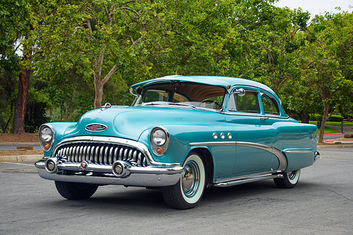 AUT 21 RK3736 01 © Kimball Stock 1953 Buick Special Deluxe 48D Azure Aqua 3/4 Front View By Trees And Pavement