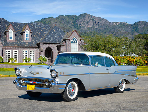 AUT 21 RK3743 01 © Kimball Stock 1957 Chevrolet Bel Air 2-Door Hardtop Silver And White 3/4 Front View By Mansion And Mountains In The Distance
