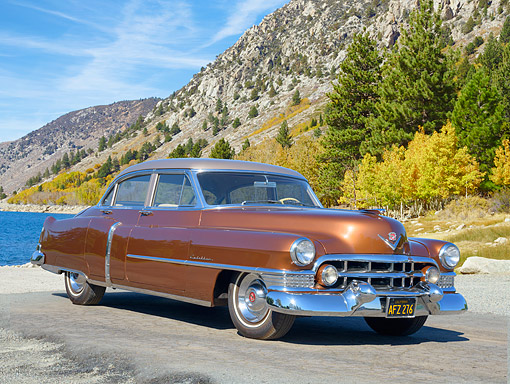 AUT 21 RK3744 01 © Kimball Stock 1951 Cadillac Series 62 Four Door Sedan Brown 3/4 Front View By Mountain Lake