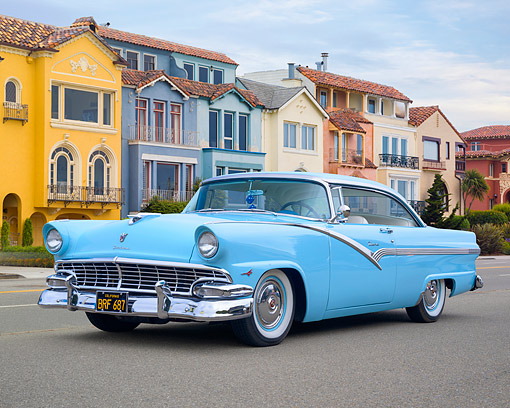 AUT 21 RK3746 01 © Kimball Stock 1955 Ford Fairlane Crown Victoria Thunderbird V-8 Blue 3/4 Front View By Suburban Backdrop