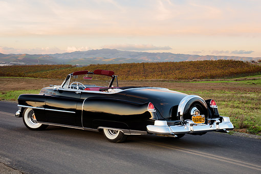 AUT 21 RK3754 01 © Kimball Stock 1950 Cadillac Series 62 Convertible Black 3/4 Rear View By Hills