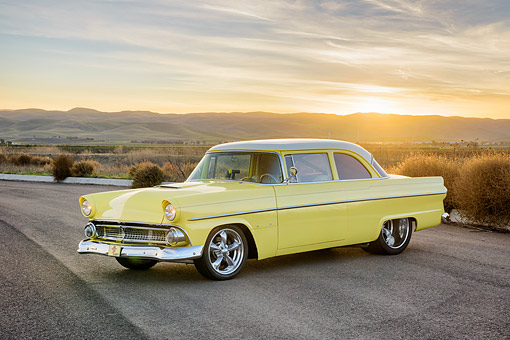 AUT 21 RK3759 01 © Kimball Stock 1955 Chevrolet Bel Air Custom Yellow 3/4 Front View On Desert Road At Sunset