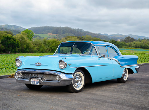AUT 21 RK3765 01 © Kimball Stock 1957 Oldsmobile Super 88 Light Blue 3/4 Front View By Hills