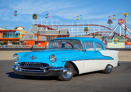AUT 21 RK3768 01 © Kimball Stock 1955 Oldsmobile Rocket 88 Blue 3/4 Front View By Amusement Park
