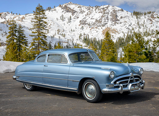 AUT 21 RK3770 01 © Kimball Stock 1951 Hudson Commodore 8 Blue 3/4 Front View By Snowy Mountains